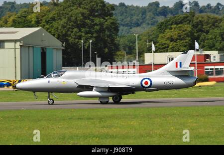 Hawker Hunter T7 fighter jet XL577 taking off during the Dunsfold airshow in Surrey, England on August 23, 2014. - Stock Photo