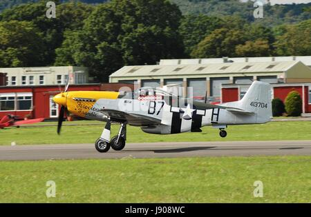 P-51D Mustang fighter Ferocious Frankie taking off during the Dunsfold airshow in Surrey, England on August 23, - Stock Photo