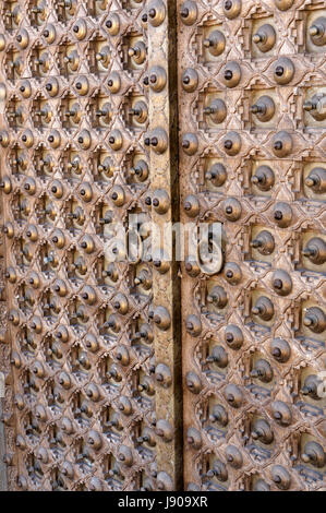 Close-up detail of ornate antique Rajasthani haveli door from Rajasthan, India - Stock Photo