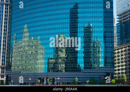 View from Chicago River Illinois modern contemporary glass reflections mirror skyscrapers high-rises buildings property - Stock Photo