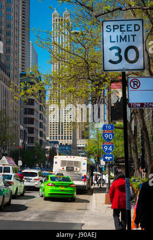 Chicago Illinois Near North Side Magnificent Mile N Michigan Avenue street scene traffic cars street signs sign - Stock Photo