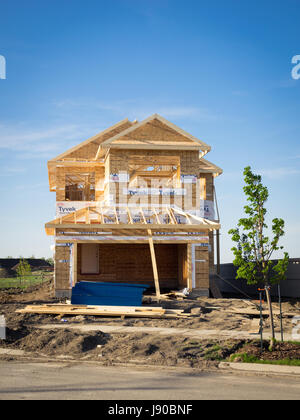 A two-storey residential house under construction in the Edmonton suburb of Beaumont, Alberta, Canada. - Stock Photo