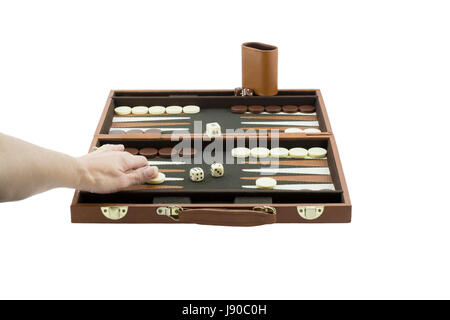 A woman's arm playing backgammon by throwing moving the checkers on the backgammon board with her left hand. Isolated - Stock Photo