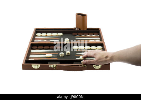 A woman's arm playing backgammon by moving the checkers on the backgammon board with her right hand. Isolated on - Stock Photo