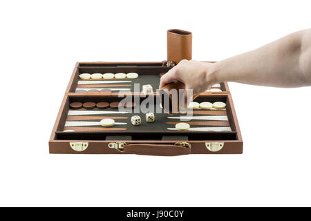 A woman's arm playing backgammon by throwing the die on the backgammon board with her righ hand. Isolated on a pure - Stock Photo