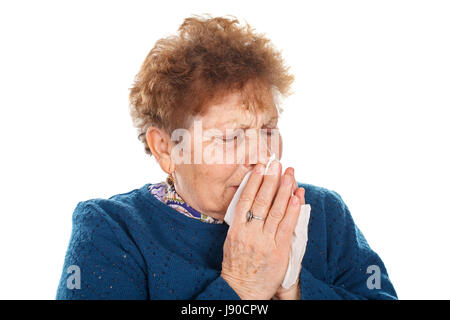 Picture of an elderly woman having a flu - isolated background - Stock Photo