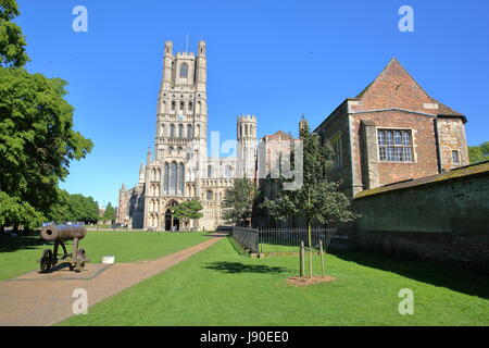 View of The West front of the Cathedral from a public garden with a gun in the foreground in Ely, Cambridgeshire, - Stock Photo