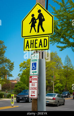 Illinois Oak Park Chicago Avenue street scene road street sign signs Reserved Parking No Parking Bus loading zone - Stock Photo