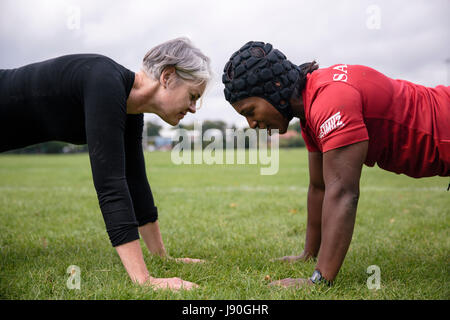 Maggie Alphonsi works on exercises that help with core strength and balance. - Stock Photo