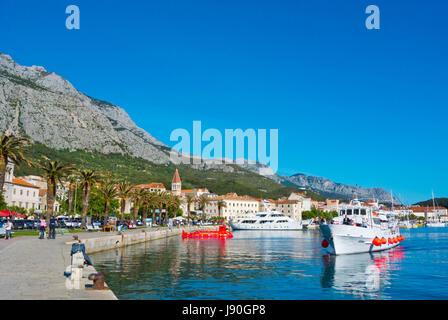 Tourist cruise arriving, Obala kralja Tomislava, seaside promenade, Makarska, Dalmatia, Croatia - Stock Photo