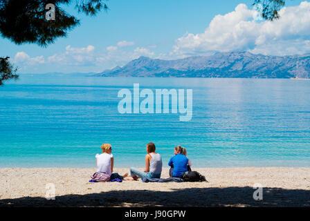 People on Plaza Donja Luka, the main beach, Makarska, Dalmatia, Croatia - Stock Photo