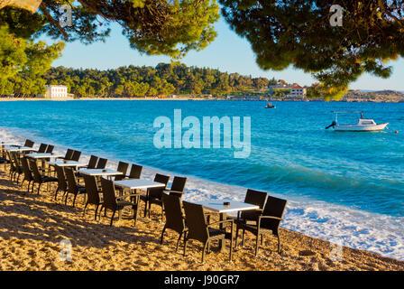Bar seating by the sea, Plaza Donja Luka, main beach, Makarska, Dalmatia, Croatia - Stock Photo