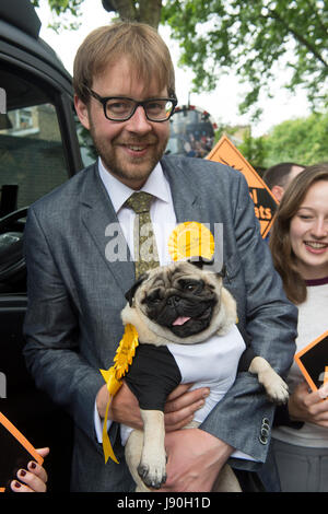George Turner, Liberal Democrat candidate for Vauxhall, with a Pug dog called Nelson following the launch in central - Stock Photo
