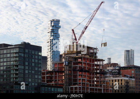 Contextual exterior view with a neighbouring building under construction in the foreground. 56 Leonard Street, New - Stock Photo
