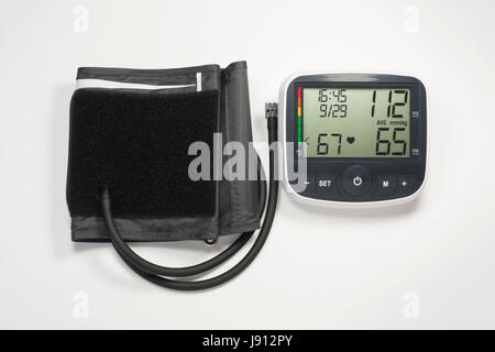 Upper Arm Blood Pressure Monitor Isolated on White Background (with clipping path) - Stock Photo
