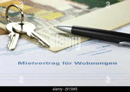 German lease contract with rent index on desktop - Stock Photo