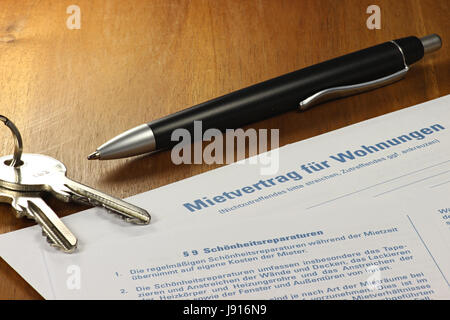 German lease contract on desktop - Stock Photo