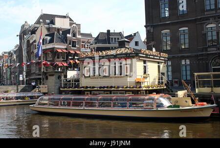 Amsterdam Rokin Canal at Oude Turfmarkt street, headquarters of Rederij Kooij canal cruises - Stock Photo