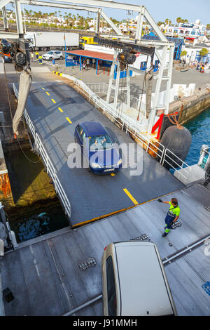 Playa Blanca, Lanzarote, 01 April, 2017: Top view of vehicle and passenger ferry.  The ferry runs several times - Stock Photo