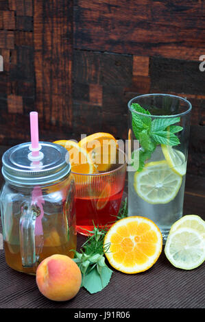smoothies and fruit juices in glass glasses - Stock Photo