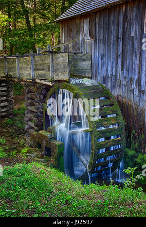 Water still flows and still turns the wheel in the century (plus) old Cable Grist Mill in the Cades Cove section - Stock Photo