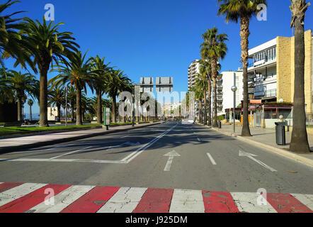 Road along promenade of Salou, province of Tarragona, in Catalonia. Spain - Stock Photo