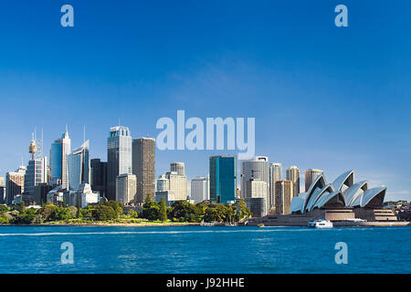 Sydney Australia view from ferry to royal botanic garden, City CBD and downtown houses on a sunny winter day. - Stock Photo