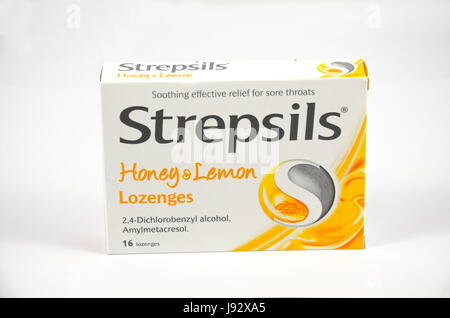 A box of Strepsils throat lozenges isolated against a white background. - Stock Photo