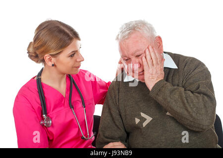 Picture of an old man having a serious migraine - isolated background - Stock Photo