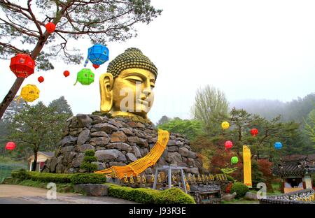 Golden head big Buddha statue with body made from stones, The Yunwha Mountain Wowoojongsa or Wawoo Jeongsa Temple, - Stock Photo