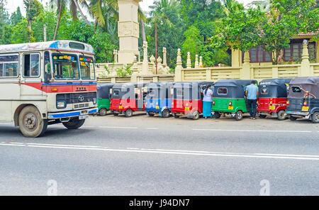 PERADENIYA, SRI LANKA - NOVEMBER 28, 2016: Big, old and noisy buses are the most common passenger transport, operate - Stock Photo