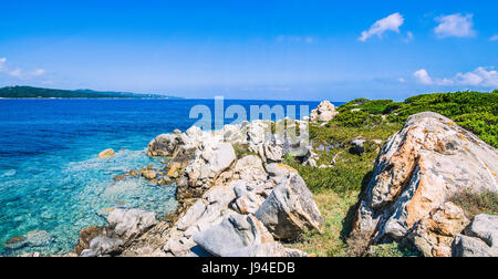 Bizarre granite rocks and amazing azure water on beautiful Sardinia island near Porto Pollo, Sargedna, Italy - Stock Photo