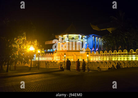 KANDY, SRI LANKA - NOVEMBER 28, 2016: Evening is the best time to enjoy the great view of Temple of Sacred Tooth - Stock Photo
