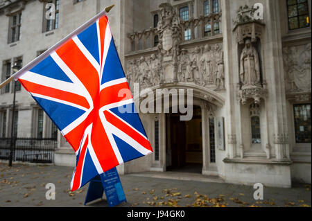 British Union Jack flag flying in front of The Supreme Court of the United Kingdom in the public Middlesex Guildhall, - Stock Photo