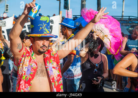 RIO DE JANEIRO - FEBRUARY 18, 2017: An afternoon carnival street party in Ipanema draws crowds of Brazilians and - Stock Photo