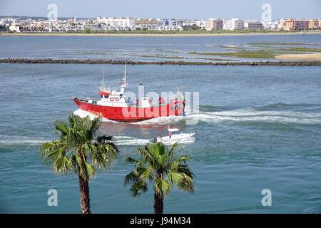 Sea Fishing Boat Isla de Canela Costa del la Luz Spain in River Estuary Returning Port with their catch - Stock Photo