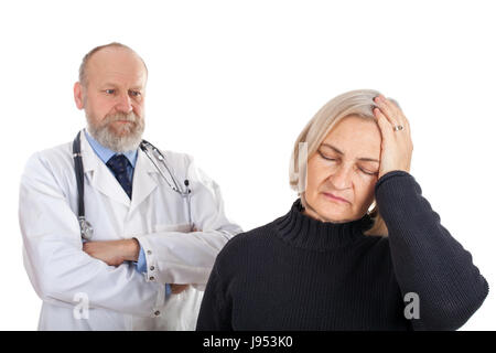 Picture of an elderly woman having a migraine standing with her doctor - Stock Photo