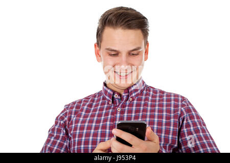 Picture of a happy young man sending a text message - Stock Photo