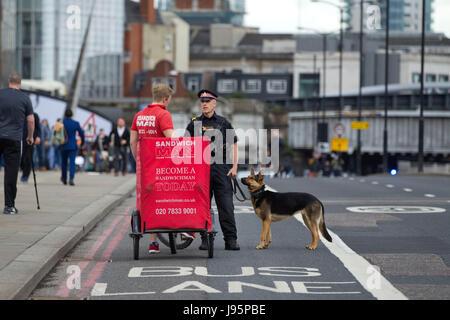 London Bridge, London, UK. 5th Jun, 2017.A sandwich courier is stopped by Metropolitan Police Dogs team on the London - Stock Photo