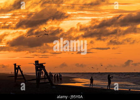 South Carolina, USA. 5th Jun, 2017. People gather along the beach to watch the sunrise on a cloudy morning June - Stock Photo