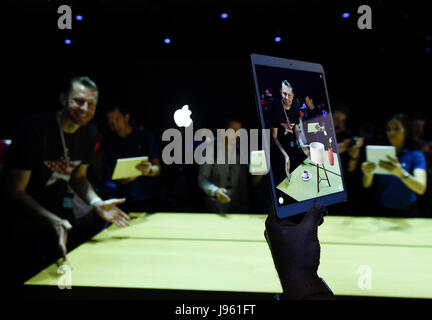 San Jose. 6th June, 2017. People try iPad Pro during an event to announce new products at the Worldwide Developers - Stock Photo