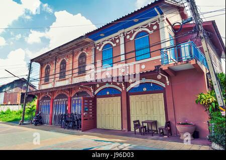 Classic Sino-Portuguese architectural style shophouse building at Ban Singha Tha, old historic area of Yasothon - Stock Photo