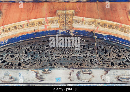 Wood carving and stucco ornaments decorating above the entrance door of the classic Sino-Portuguese architectural - Stock Photo