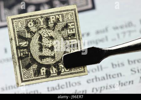 one kreuzer black, first German postage stamp issued in the Kingdom of Bavaria - Stock Photo