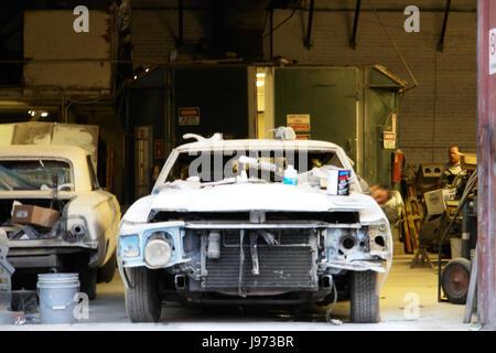 Broken car in workshop mechanical bodywork - Stock Photo
