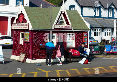 Asian tourists buying tickets for Manx Electric Railway in Douglas, Isle of Man - Stock Photo