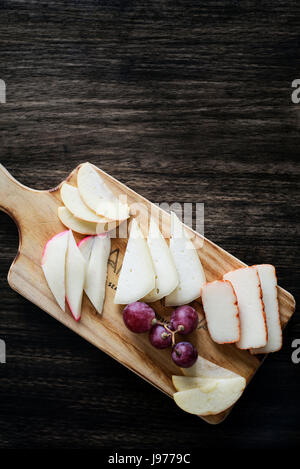 mixed portuguese cheese tapas snack platter with apple and grapes set - Stock Photo