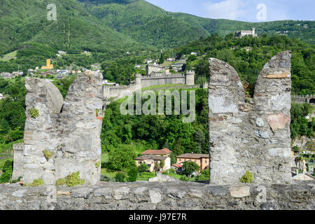 Castle Montebello and Corbaro view from Castelgrande at Bellinzona on the Swiss alps - Stock Photo