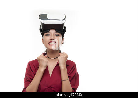 Action scene of Young attractive Asian businesswoman in red shirt ready to use VR Glasses. Virtual Reality experience for busniess activity in future