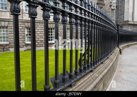 The railings on the outside of Trinity College in Dublin, Ireland - Stock Photo
